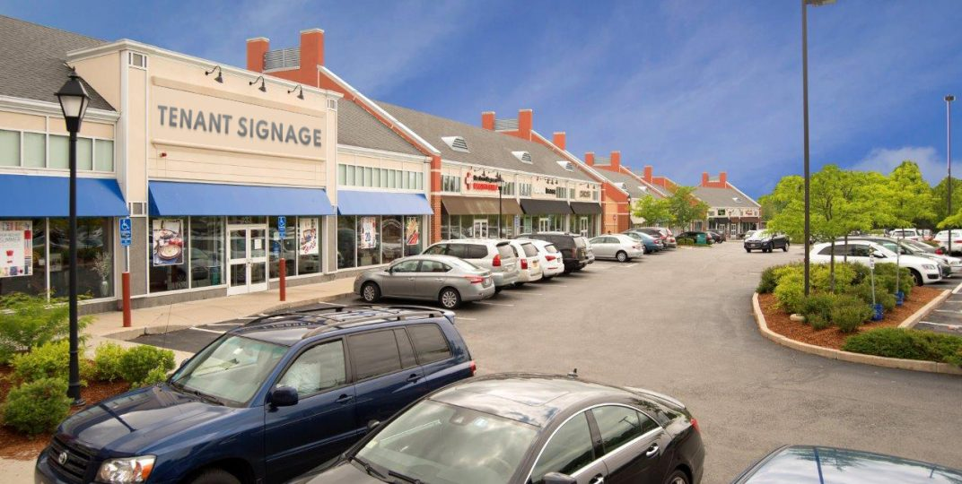 Photo of Eaglewood Shops in North Andover with tenant signage rendering